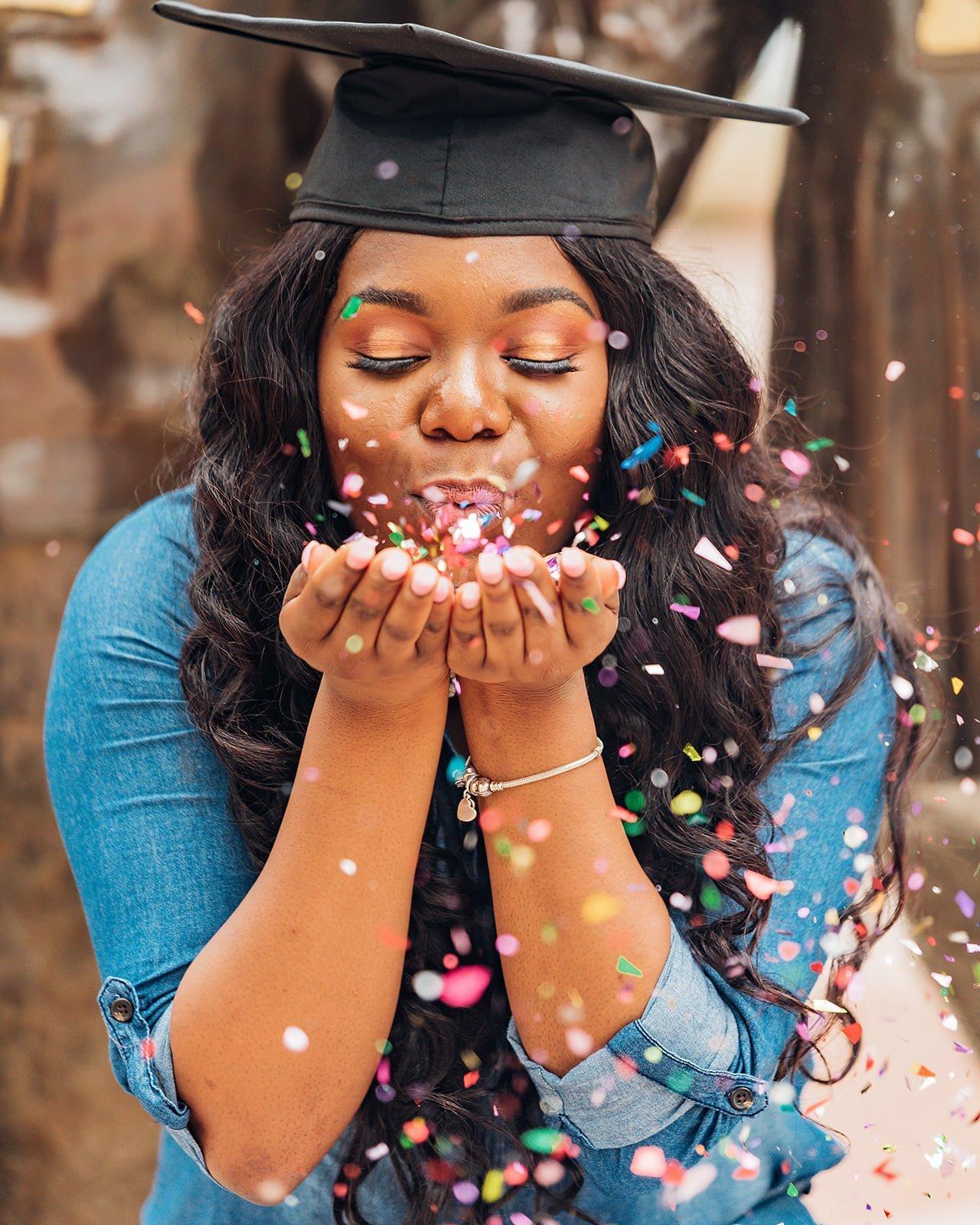 Graduation photoshoot with confetti.
