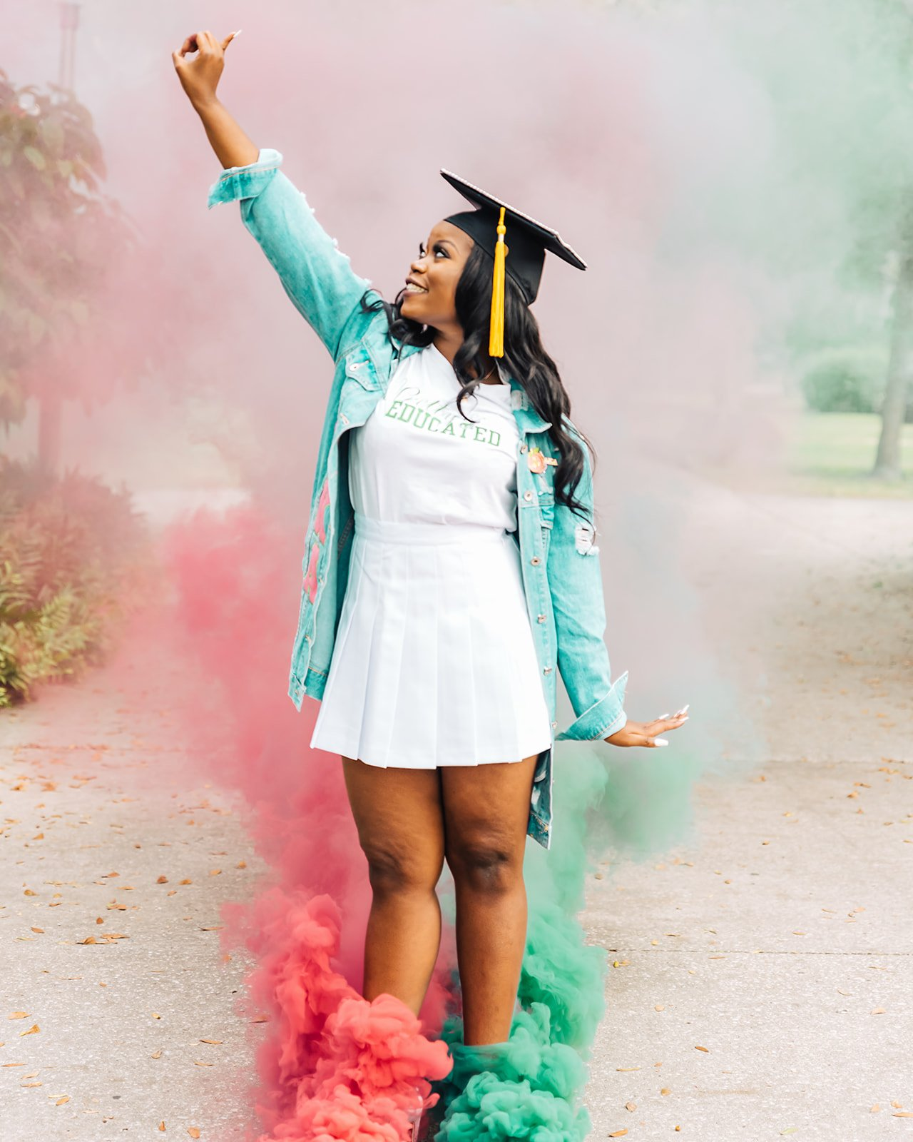 Graduation photoshoot with colored smoke.
