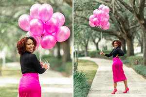Woman holding pink balloons